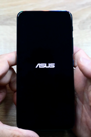 """A black boot screen with the """"ASUS"""" logo in white"""