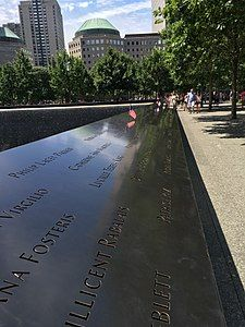 A black plaque with engravings of the names of people who died in the September 11 attacks