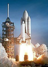 The Space Shuttle Columbia launching on the first Space Shuttle mission
