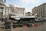 A fighter jet parked in the street