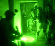 Paratroopers in Fallujah, Iraq conduct a night raid using Night Vision Goggles
