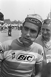"""A picture of a cyclist in a jersey that reads """"Bic."""""""