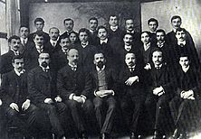 Three rows of Pontic Greek men in western suits, standing or seated close together.