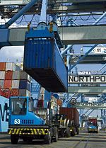 A container being loaded on a prime mover in Northport. Container being loaded on one of the Prime Mover.