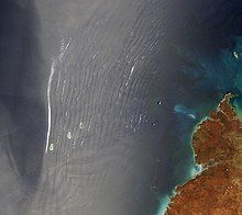 wave clouds observed over the ocean, seen from a satellite
