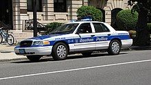 White Boston Police car with blue and gray stripes down the middle
