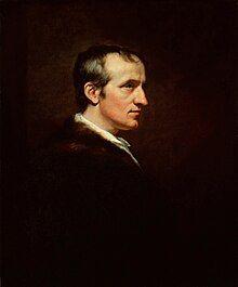 一个男人(威廉·戈德温)的半身侧面肖像。他的深色衣服与背景融为一体,白色的脸庞形成了鲜明的对比