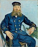 A portrait of a middle aged man with a moustache and beard seated on a chair facing to his left (the viewer's right). He has a thoughtful look on his face and his hands are free while his left arm rests on a table, he is wearing a dark blue uniform and cap, in front of a pale blue background.