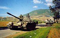 Albanian army deploys T-59 tanks near Kosovo border, May 1999 (Robert Wright).jpg