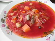 A bowl of borscht with beans and other vegetables