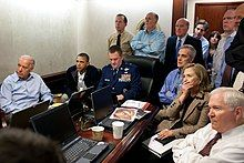 President Barack Obama and Vice President Joe Biden, along with members of the national security team, receive an update on Operation Neptune's Spear, a mission against Osama bin Laden, in one of the conference rooms of the Situation Room of the White House, on May 1, 2011. They are watching the live feed from drones operating over the bin Laden complex.