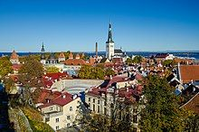 The spire of St. Olaf's Church in Tallinn looks over the city and the Gulf of Finland