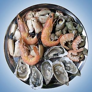 A seafood platter composed of shrimp, oyster, snail and crab.