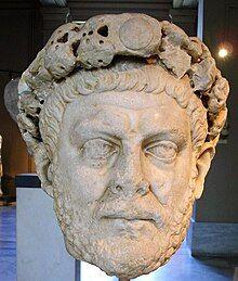 Statue of a male head wearing a diadem