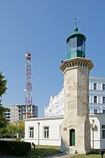 Restorated medieval lighthouse and modern radio tower.jpg