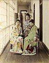 Three Maiko posing on an engawa, c. 1885. Hand-coloured albumen silver print.
