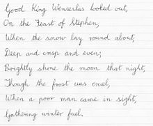 """The first verse of """"Good King Wenceslas"""" in cursive"""