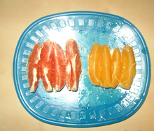 Slices of common and cara cara oranges on a plate