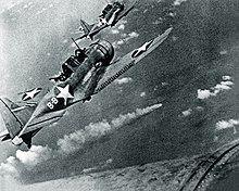 SBD-3 Dauntless bombers of VS-8 over the burning Japanese cruiser Mikuma on 6 June 1942.jpg