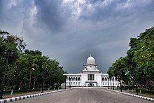 Long, white, domed building