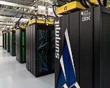 Rows of large, dark computer cabinets in warehouse-like room