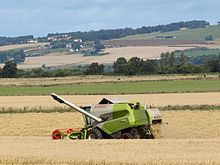 A combine harvester in use