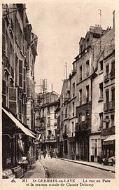 Old postcard showing French street scene in a not very upmarket area