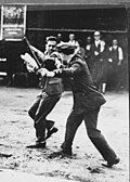 A police officer confronts a striking longshoreman, San Francisco 1934