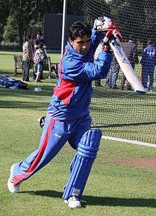 Hasti Gul swinging a bat in practice