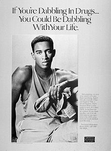 """A black-and-white poster of a young black man with a towel in his left hand with the words """"If you are dabbling with drugs you could be dabbling with your life"""" above him"""
