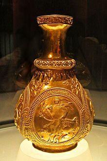 A jug with golden medallions.jpg