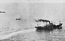 Two aircraft fly after a ship at very low altitude