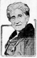 A black-and-white photograph of the head and shoulders of a woman