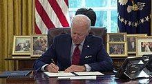 Biden signing an executive order related to the Affordable Care Act and Medicaid.jpg