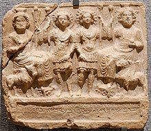 Bas-relief of four human-looking gods