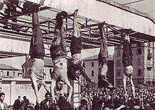 corpses hanging by feet including Mussolini next to Petacci at Piazzale Loreto, Milan, 1945