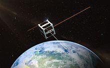ESTCube-1 micro satellite orbiting globe and beaming light to Estonia