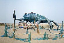 Sculpture of a crab made from discarded plastic