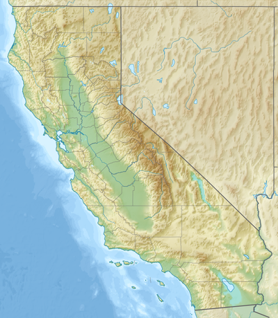 A topographic map of California with the UC campuses marked