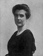 A black-and-white photograph of the head and upper body of a woman