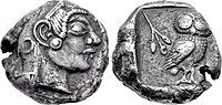 Both sides of a silver coin. One side shows a head in profile; the other an owl.