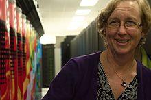 Kathy Yelick in front of Hopper Cray XE6