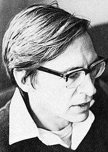 Black-and-white portrait photograph of a man wearing glasses