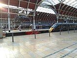 Paddington railway station with sun shining through the arches built by Brunel