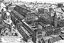 A black and white engraving of a bird's-eye view of a very large cruciform church. There is a large enclosed forecourt which is fronted by buildings of different dates and styles. There is a tall bell tower and many surrounding structures. A label to the bottom left of the image gives the artist's name and original caption.