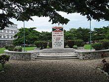flag sign at flagpole and raised plaza