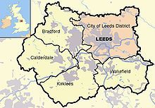 Leeds district (pink),other four metropolitan boroughs of West Yorkshire (clockwise from Leeds: Wakefield, Kirklees, Calderdale and Bradford). County and borough boundaries are black, urban areas grey, motorways blue with white stripe, rivers and bodies of water light blue. A Great Britain inset map shows West Yorkshire highlighted.