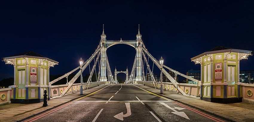 Albert Bridge at night, looking south across the Thames to Battersea, a suburb in South West London.