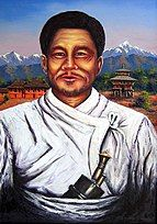 """Portrait of Lakhan Thapa; a kukri knife tucked in his """"patuka"""" waistband is prominent."""
