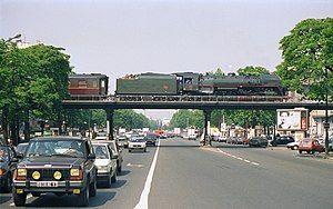 Steam locomotive and train on the cours de Vincennes bridge